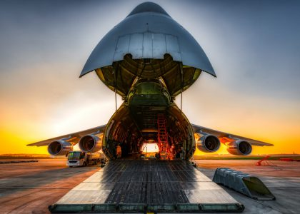 antonov an-124 on the ground with wide open freight room, fuel stop