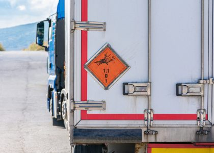 Truck transporting explosives, danger label according to the ADR identifies explosives in the transport of dangerous goods.